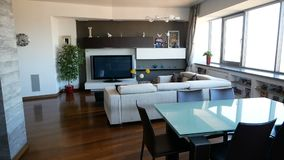 Apartment interior with sofa, modern table with chairs and tv stock video footage