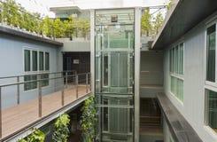 Apartment interior. With walkway bridge and glass lift Stock Photo