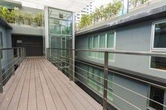 Apartment interior. With walkway bridge and glass lift Stock Photos