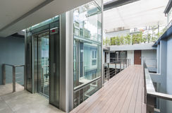 Apartment interior. With walkway bridge and glass lift opened Stock Images