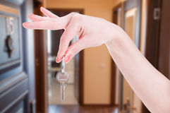 Apartment key in woman hand Royalty Free Stock Images