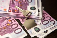 Apartment keys on the background of banknotes. Ptmsp 500 Euro banknotes Money on stock photography