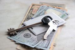 Wealth and riches represented by cash money and keys. apartment keys of dollars. concept realtor`s work exchange key on money. royalty free stock photos