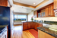 Apartment kitchen with water view and granite. Stock Photography