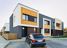 Apartment modern town house residential building and car parked. In the street stock image