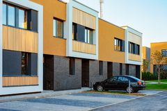 Apartment modern townhouse residential building and car parked. In the street royalty free stock image