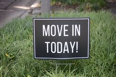 Apartment Move-In Sign. A sign advertises that people looking for an apartment can move in immediately if they sign a lease rental agreement with this apartment Stock Images