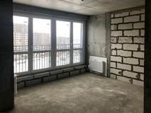 The apartment in the new building with a free layout without repair and decoration with bare walls a large panoramic French window royalty free stock photo
