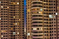 Apartment at night. Apartment building at night in high populated city Royalty Free Stock Photos