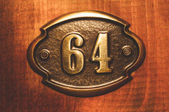 Apartment number sixty four close up photo Stock Photography