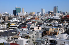 Apartment and Office Buildings In Tokyo Japan. Densely populated apartment buildings around Harajuku near Shibuya in Tokyo Japan on clear spring day Royalty Free Stock Photography
