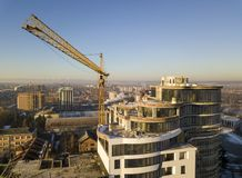 Free Apartment Or Office Tall Building Under Construction, Top View. Tower Crane On Bright Blue Sky Copy Space Background, City Royalty Free Stock Image - 142086516