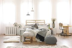 Apartment with pallet bed Royalty Free Stock Images