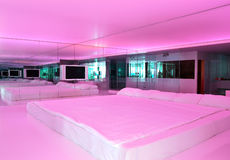 Apartment with pink illumination in ultra modern Stock Photo