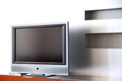 Apartment with Plasma television. A wide screen television and entertainment system are the focal point in the family room of a new home Stock Photography