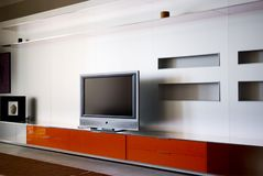 Apartment with Plasma television ... A wide screen television and entertainment system are the focal point in the family room of a new home Royalty Free Stock Images