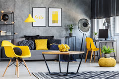 Apartment with pop of yellow. Fresh and playful apartment interior with pop of lemon yellow color royalty free stock image