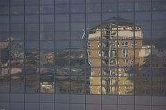 Apartment reflection. An apartment block reflected in office windows Royalty Free Stock Photos