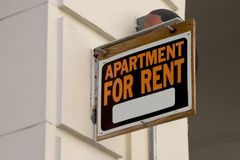 Apartment for Rent Sign. A for rent sign on display on the side of a down town apartment building Royalty Free Stock Photography