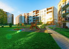 Apartment residential house facade architecture and child playground sun light. Apartment residential house facade architecture and child playground and outdoor royalty free stock photo