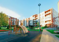 Apartment residential house facade architecture with child playground sun light. Apartment residential house facade architecture with child playground and stock photography