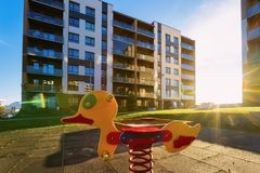 Apartment residential house facade architecture and children playground sun light. Apartment residential house facade architecture and children playground and royalty free stock image
