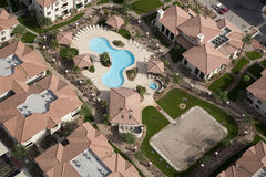 Apartment Rooftops. Overhead view of Apartment Rooftops with Pool and Volleyball Royalty Free Stock Images