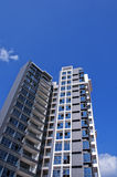 Apartment in sun. Modern apartment buildings in the blue sky stock photography