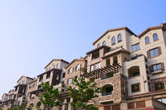Apartment  in  sun. Modern apartment buildings in the blue sky Royalty Free Stock Photo