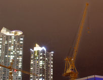 Apartment Tower with Construction Cranes Royalty Free Stock Image