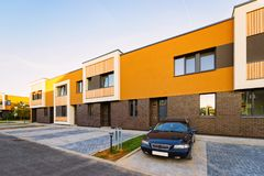 Apartment town house residential building and car parked. In the street stock photo