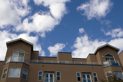 Apartment under cloudy sky Stock Images