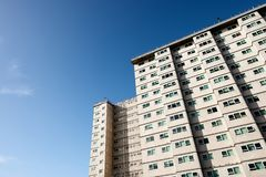Social housing apartment tower block against a blue sky. royalty free stock image
