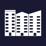 Apartment vector isolated. Office building. White vector icon on blue background. Royalty Free Stock Photography