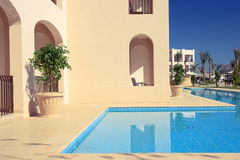 Apartment with water pool in tropical hotel. Stock Images