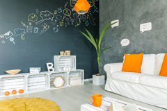 Apartment with white sofa. Blackboard wall and diy furniture Royalty Free Stock Photo