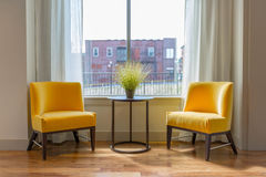 Apartment Window and Chairs  Stock Images