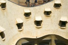 Apartment windows of Casa Mila or La Pedrera (the Stone Quarry) by Antoni Gaudi, built between 1905-1911, Barcelona, Spain Stock Photos