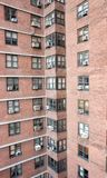 Apartments. Abstract of a brick wall with windows in an apartment building Stock Images