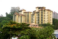 Apartments. Apartment buildings in Malaysia, surrounded by tropical greenery Stock Image