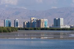 Apartments across the water in front of the mountains stock images