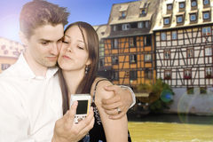 Apartments along canal. Young couple doing tourism with digital camera Royalty Free Stock Image