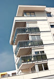 Apartments with balconies. Details of an apartment building with open balconies or lanais Stock Photo