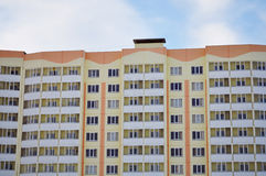 Apartments with balconies, glazed loggia. District high-rise buildings, the structure of concrete, metal and glass, home to large numbers of people, built and Royalty Free Stock Photo