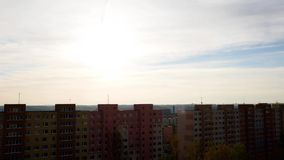 Apartments block at sunset timelapse. Timelapse of clouds moving over apartments block during sunset. Prague, Czech Republic stock video footage