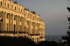 Apartments in brighton england. Classic regency architecture row of fashionable grand flats. Nice old apartments in sunset light, brighton england. Classic Stock Photo
