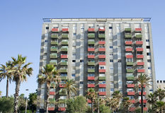 Apartments building, raw. Apartments building with red and green balconies, raw royalty free stock photography