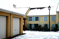 Apartments and garages in snow. A background of apartments and garages with snow on the ground stock photos