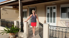 Apartments in Hersonissos. A woman stands outside the courtyard of the hotel apartments in Hersonissos. Crete. Greece stock photo