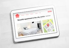 Apartments and houses online search with mobile device. Holiday home rental or real estate website or application. Imaginary internet marketplace for vacation stock photo